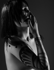 Woman with Tattoo. Black & White Portrait