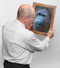 Man and mirror with his monkey face. Human evolution.
