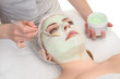 beauty salon, facial mask applying - 63073892