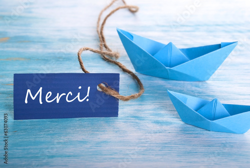 Label with Merci and Boats
