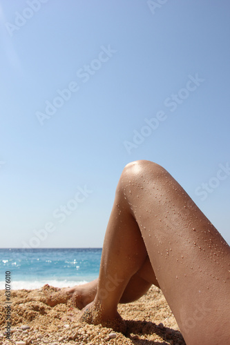 Sexy legs on the beach
