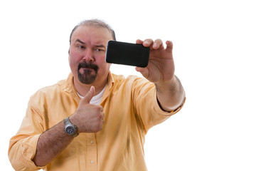 Man taking a selfie while giving a thumbs up