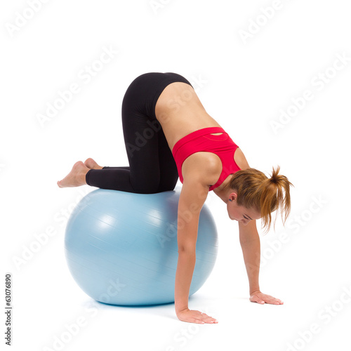 Young female exercise on fitness ball