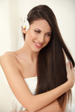 Brown Hair. Beautiful Brunette with Long Hair. Haircare poster