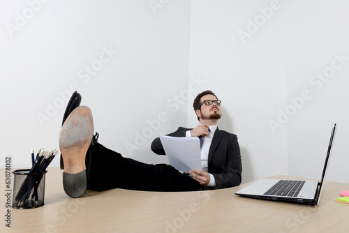 Relaxed young businessman in the office
