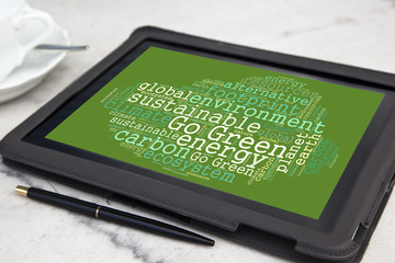 tablet with go green word cloud