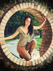 Beautiful young woman in a brick circle