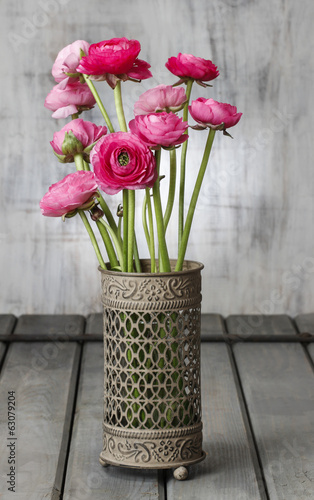Bouquet of pink persian buttercup flowers (ranunculus) on wood