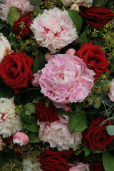 Peonies and roses in a bridal bouquet