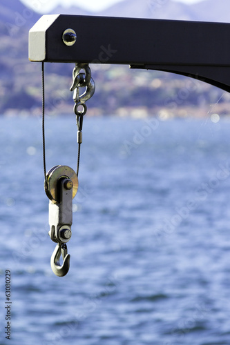 Detail of a crane for pleasure boats color image