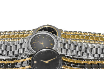 Modern style wrist watches.Sparkles shine off brushed metal