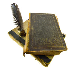Two ancient books with quill pen