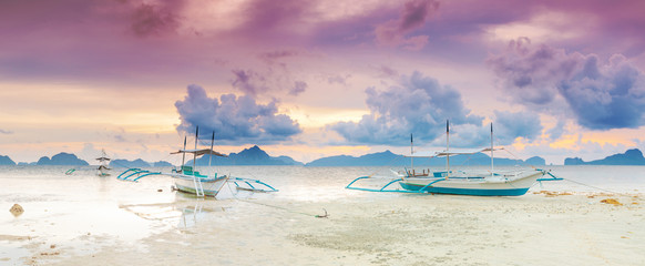 Boats at sunset. Panorama