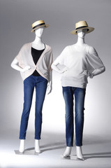 female clothes on a two mannequin in light background
