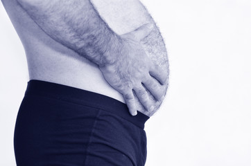 Man with belly assessing his weight