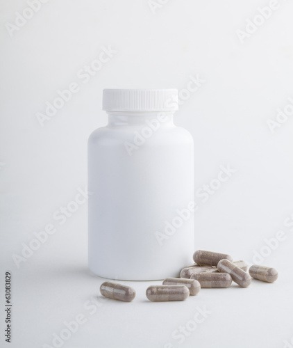 Supplementary bottle food tablets isolated on white