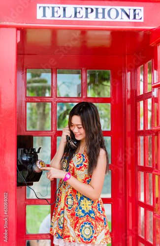 Thai girl is talking with an old-fashion phone