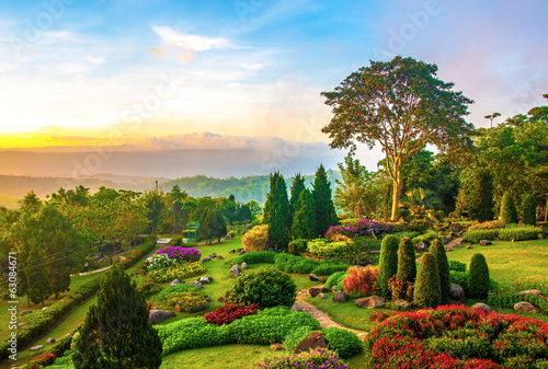 Tuinposter Tuin Beautiful garden of colorful flowers on hill