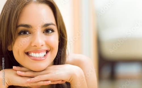 canvas print picture Portrait of young woman at home