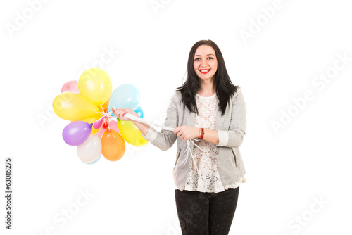 Smiling woman with many balloons