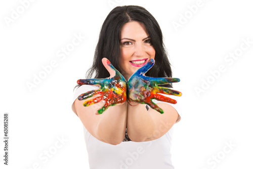 Cheerful woman showing messy colorful hands