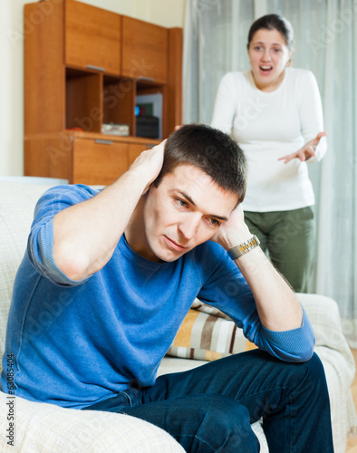 Depressedg guy listening to woman