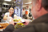 Fototapety Kitchen Serving Food In Homeless Shelter