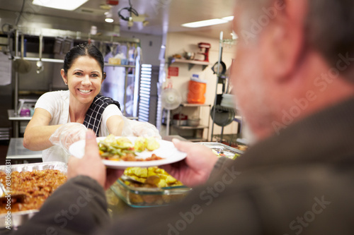 canvas print picture Kitchen Serving Food In Homeless Shelter