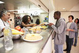 Fototapety Kitchen Serving Food In Homeless Shelter