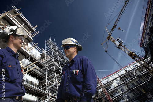construction site with workers, super-wide view