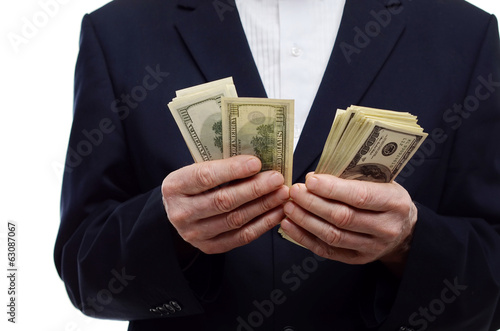 man counting money in 100 dollars bills