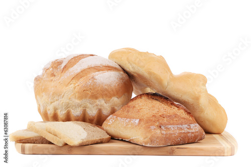 Composition of bread on cutting board.