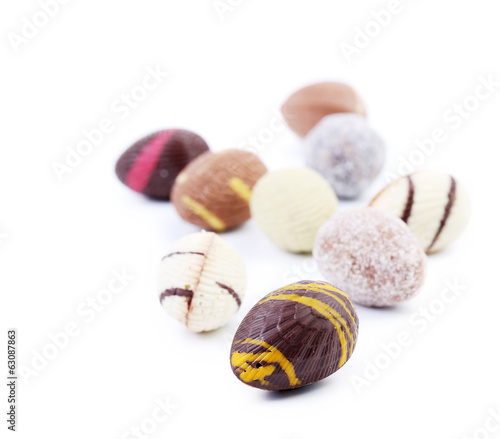 Bunch of chocolate seashells and stones.
