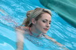 Beautiful woman floating in a swimming pool