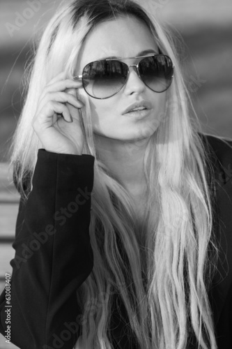 beautiful girl in sunglasses posing