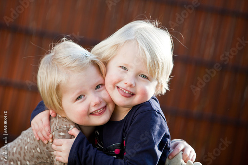 Happy twin sisters smiling
