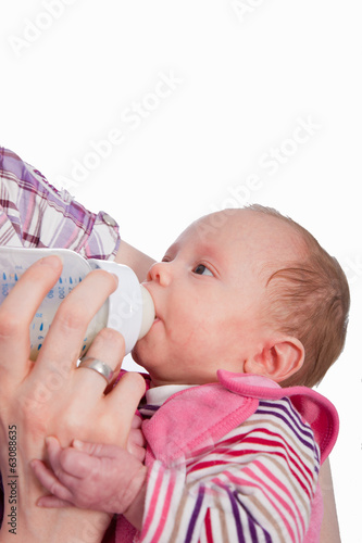 Feeding Baby eating milk from the bottle