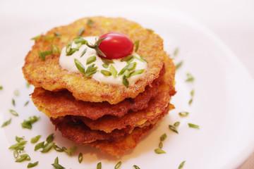 Potato pancakes with tomato