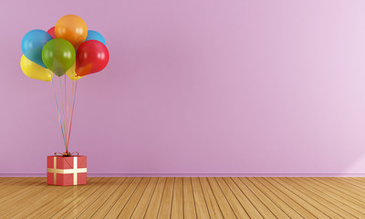 Colorful balloons in a empty pink room