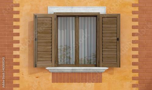 Old facade with wooden windows