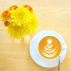 Cup of latte or cappuccino coffee with flower