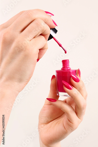 woman paints nails