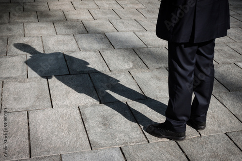 Leinwandbild Motiv Shadow of a businessman standing