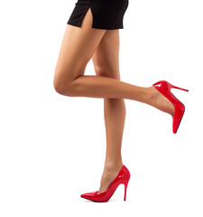 Sexy women legs in red high heel shoes