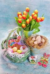 easter decoration with wicker basket and fresh tulips