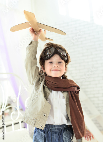 happy boy with jet airplane in hand