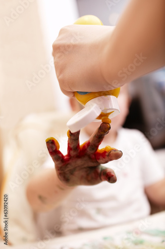 Young child playing with finger paint