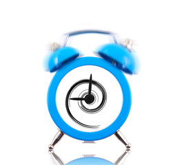 Classic alarm clock ringing with swirl inside isolated