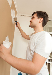 portrait of man working with spatula and putty