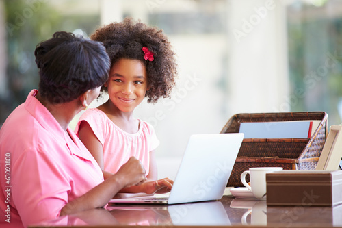 Granddaughter Helping Grandmother With Laptop